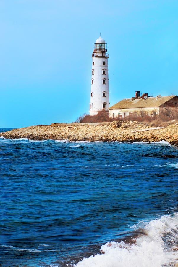 Phare sur la côte photographie stock