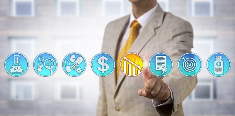 Pharma降低药物价格的业务经理 免版税库存图片