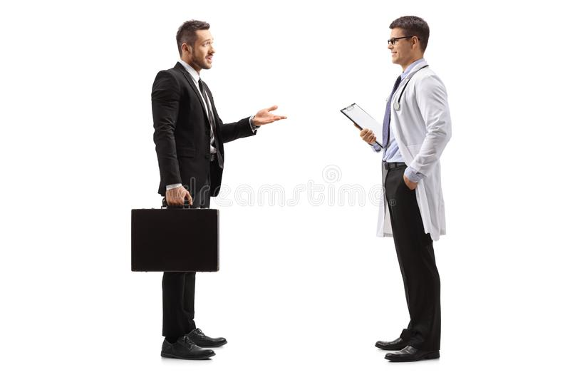 Pharmaceutical company representative talking to a doctor royalty free stock photo
