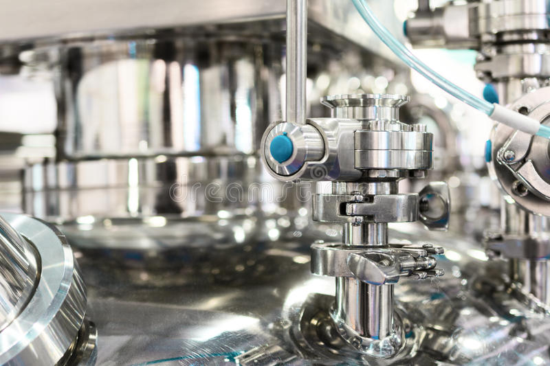 Pharmaceutical equipment, ball valve. Abstract industrial background stock images