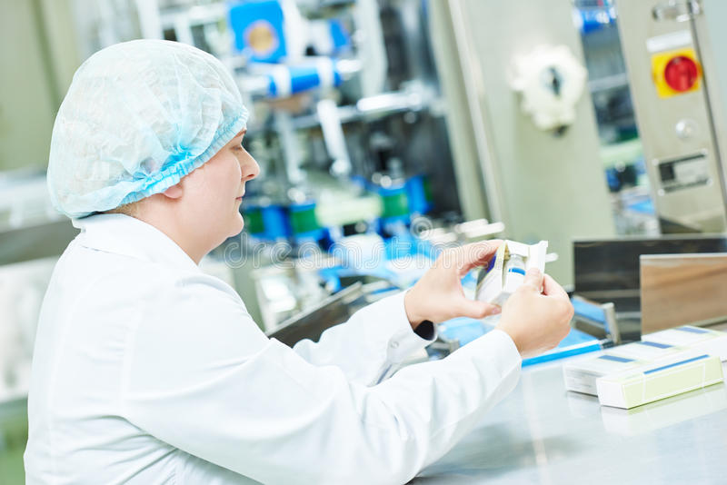 Pharmaceutical factory woman worker packing drugs. At pharmacy industry manufacture factory stock images