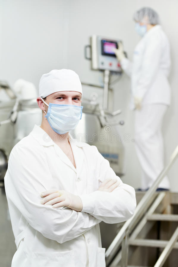 Pharmaceutical factory worker royalty free stock image