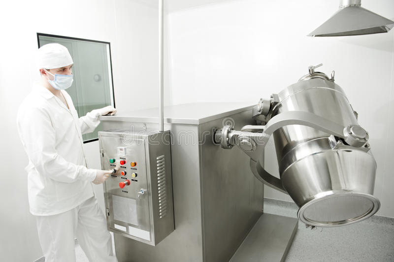 Pharmaceutical factory worker. At pharmacy industry manufacture stock photography