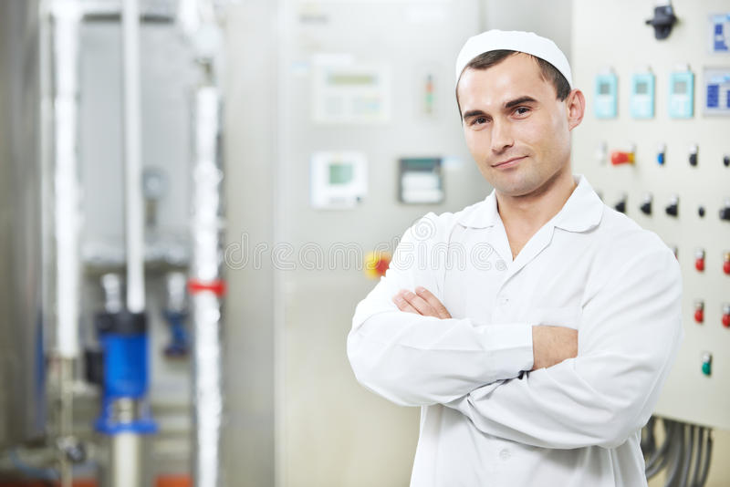 Pharmaceutical factory worker. Pharmaceutical man worker in water preparation production line hall at pharmacy industry manufacture factory royalty free stock photos