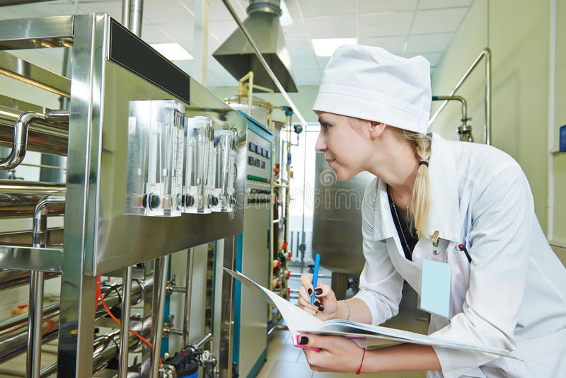 Pharmaceutical factory worker. Pharmaceutical man worker in water preparation production line hall at pharmacy industry manufacture factory royalty free stock image