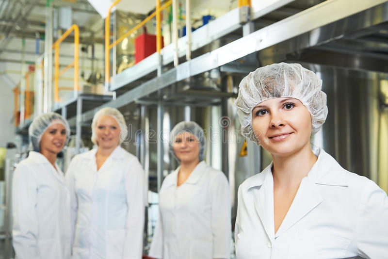 Pharmaceutical factory workers. Portrait of female pharmaceutical factory worker in pharmacy industry manufacture factory royalty free stock photography