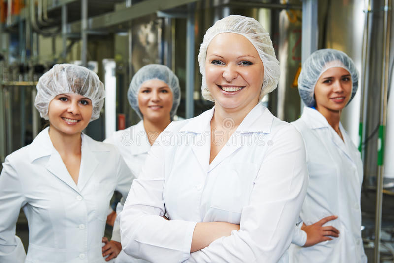 Pharmaceutical factory workers. Portrait of female pharmaceutical factory worker in pharmacy industry manufacture factory stock photos