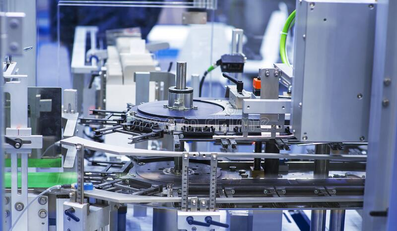 Pharmaceutical industry. Production line machine conveyor at factory with bottles.  stock image