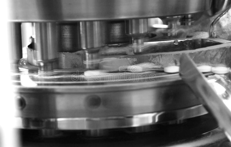 Pharmaceutical machine. And tablets in production line stock images