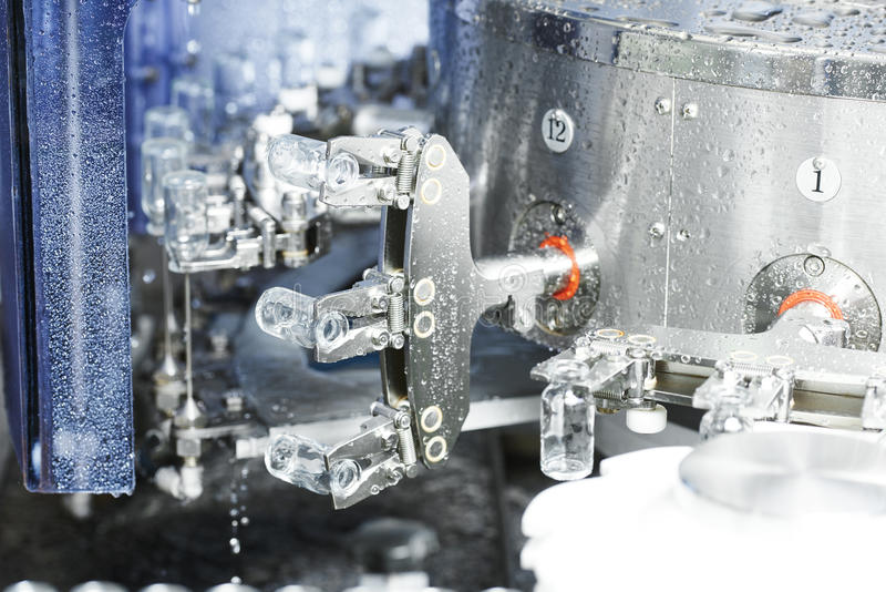 Pharmaceutical medicine industrial washer cleaning and drying ma. Chine for powder drugs glassware bottles royalty free stock photography