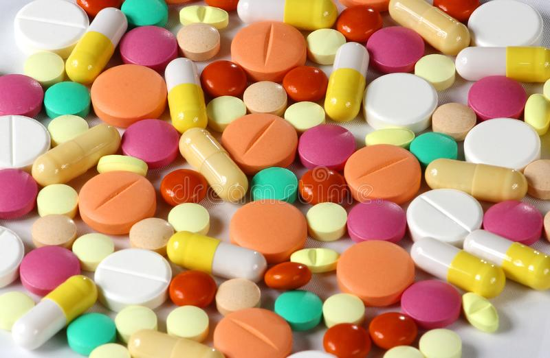 Pharmaceutical medicine pills, tablets and capsules different colors. Medicine tablets and pills. Health care. Pills background. stock images