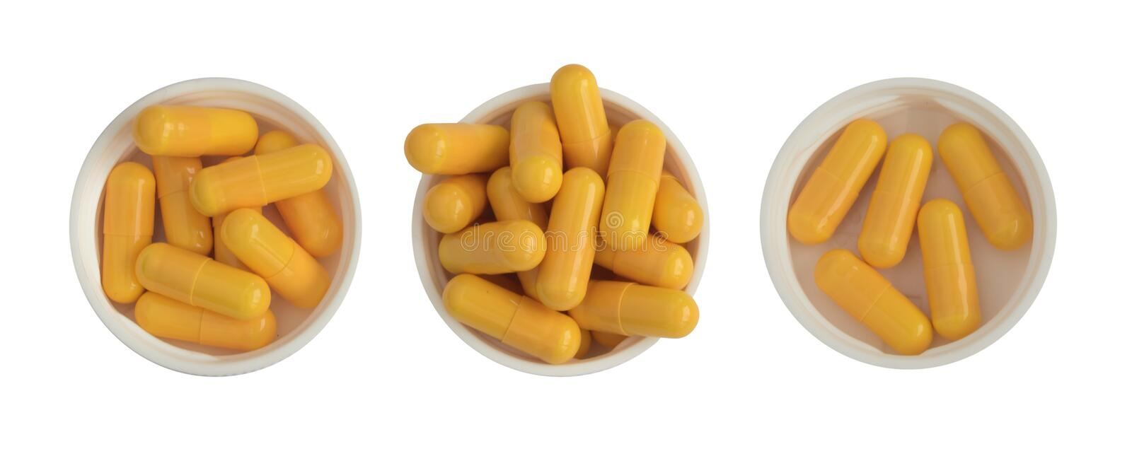 Pharmaceutical Medicine Pills and Tablets in White Plastic Cups Isolated. Yellow Pharmaceutical Medicine Pills and Tablets in White Plastic Cups Isolated stock photos
