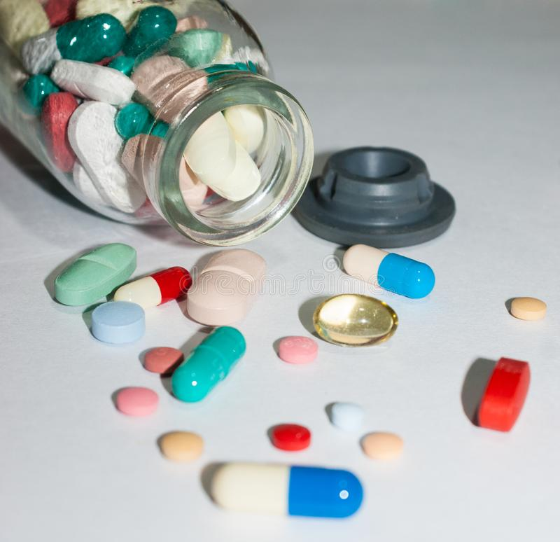 Pharmaceutical pills over the table stock photography