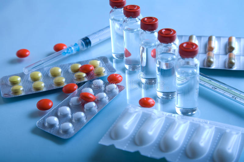 Pharmaceutical products. Syringe and pills royalty free stock photo