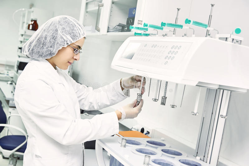 Pharmaceutical researcher making dissolution test royalty free stock photography