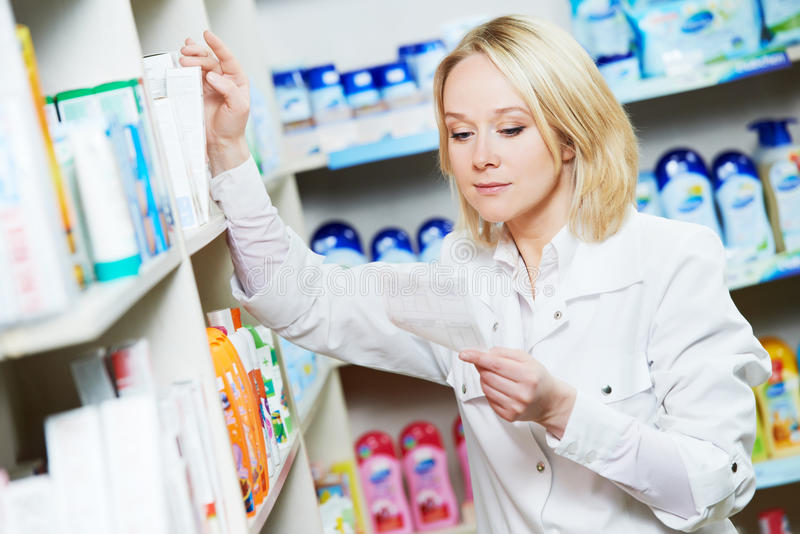 Pharmaceutist woman worker in drug store royalty free stock photography
