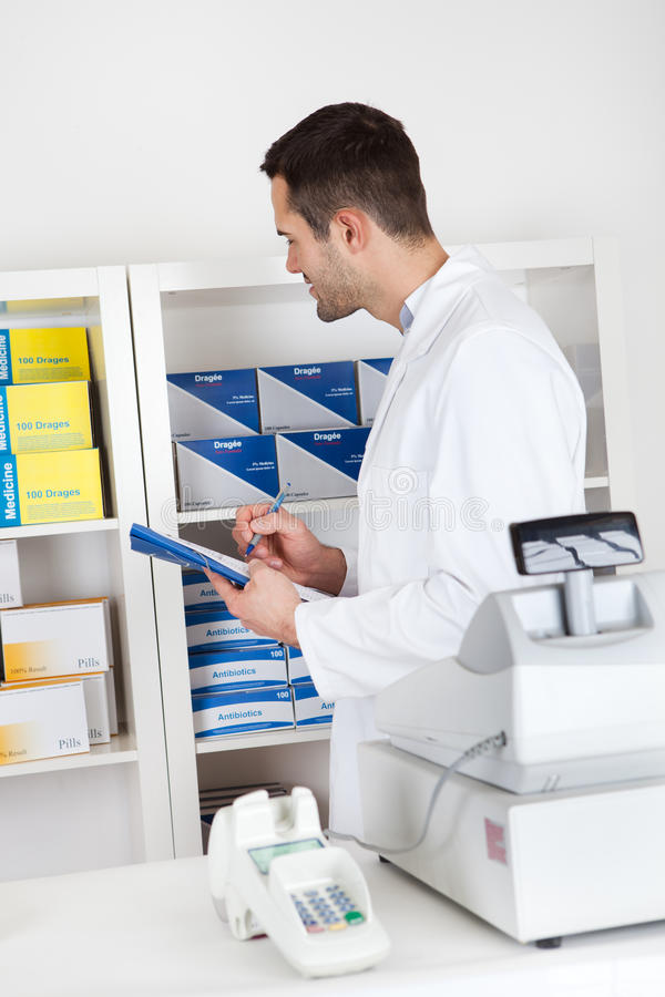 Pharmacist checking drugs royalty free stock photos