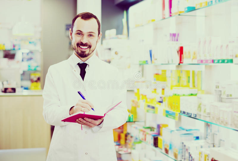 Pharmacist checking drugs in pharmacy royalty free stock photography