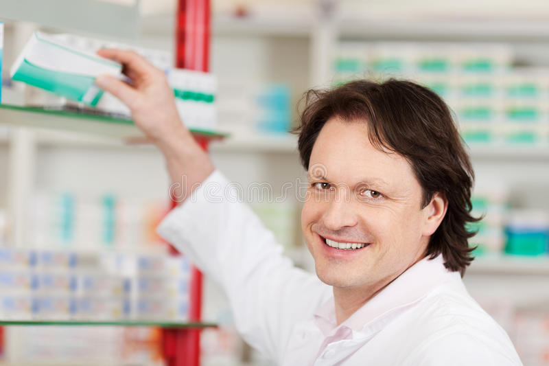 Pharmacist choosing medicine stock image