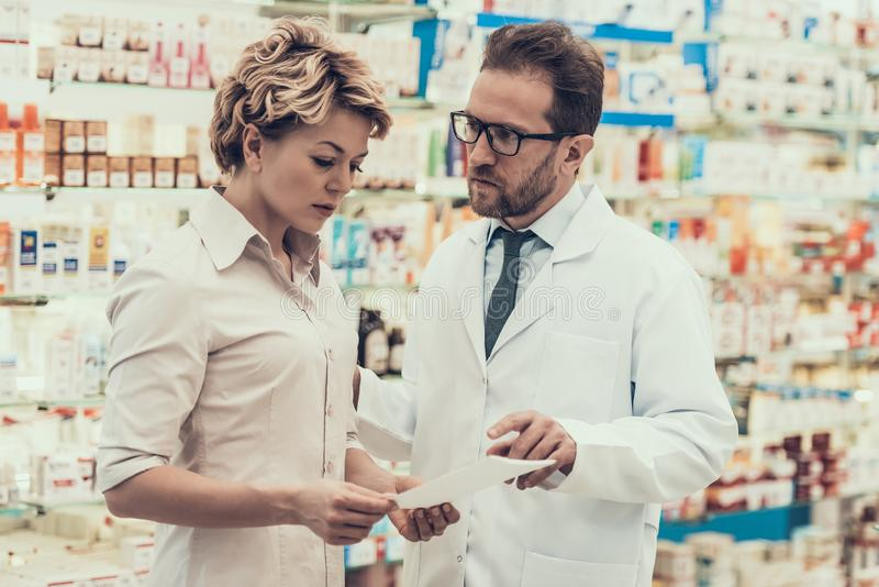 Pharmacist counseling Female Customer in Drugstore stock photos