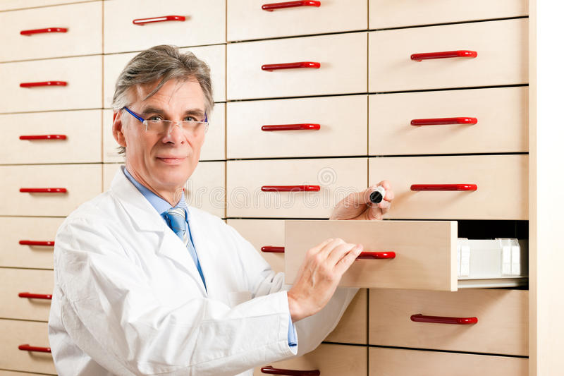 Download Pharmacist In Front Of Medicine Chest Stock Image - Image: 18729923