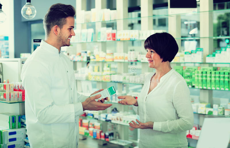 Download Pharmacist Helping Customers Stock Photo - Image: 83701528