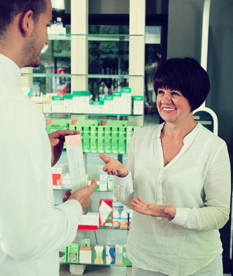 Download Pharmacist  Helping Customers Stock Photo - Image: 83701788