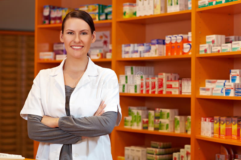 Download Pharmacist With Her Arms Crossed Stock Image - Image of advice, retail: 21736651