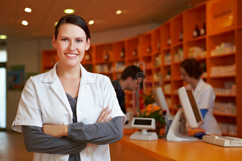 Pharmacist with her arms crossed royalty free stock images