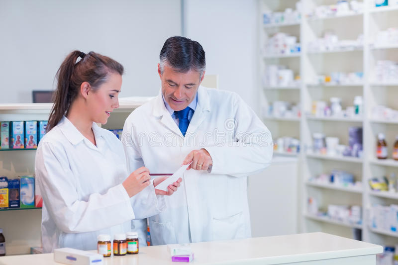 Pharmacist And His Trainee Working Together Stock Image - Image of ...
