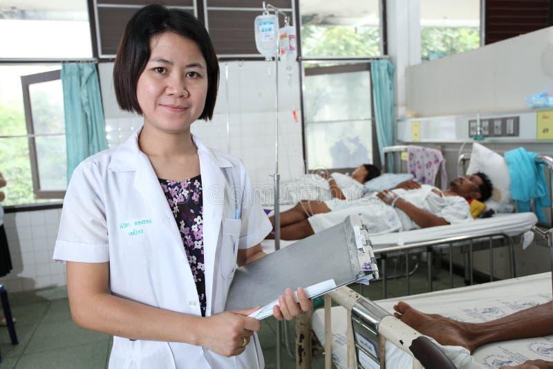 Pharmacist holding patient profile chart. UBON RATCHATHANI, THAILAND – AUG 21, 2013 : Wanwisa Tongrong holding patient profile chart on ward on Aug 21 royalty free stock photo
