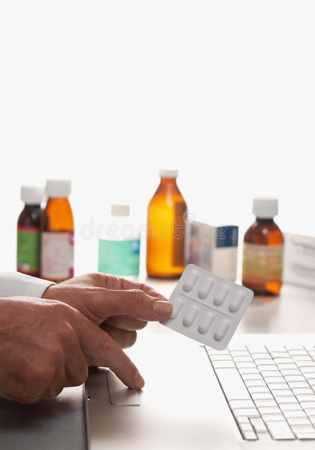 Pharmacist and laptop computer royalty free stock photo