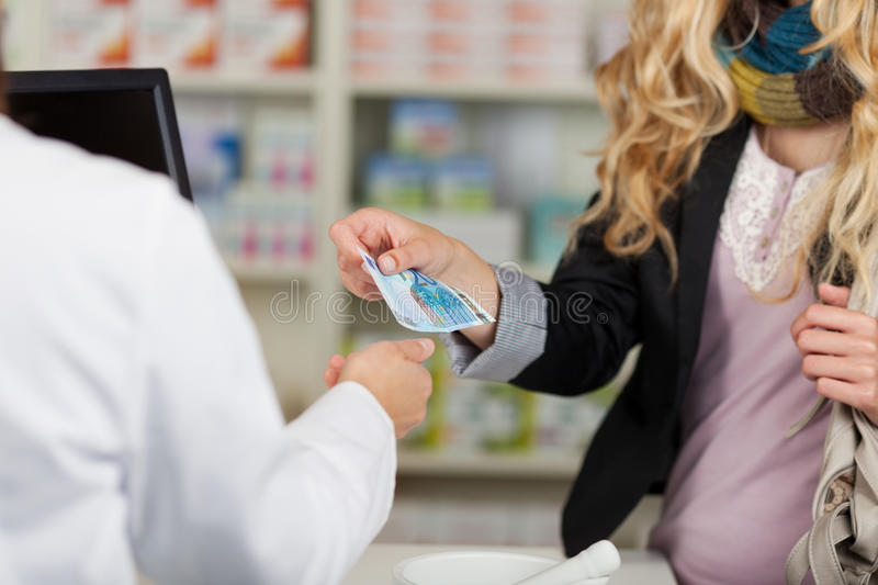 Download Pharmacist Receiving Money From Woman For Medicines Stock Image - Image: 31203791
