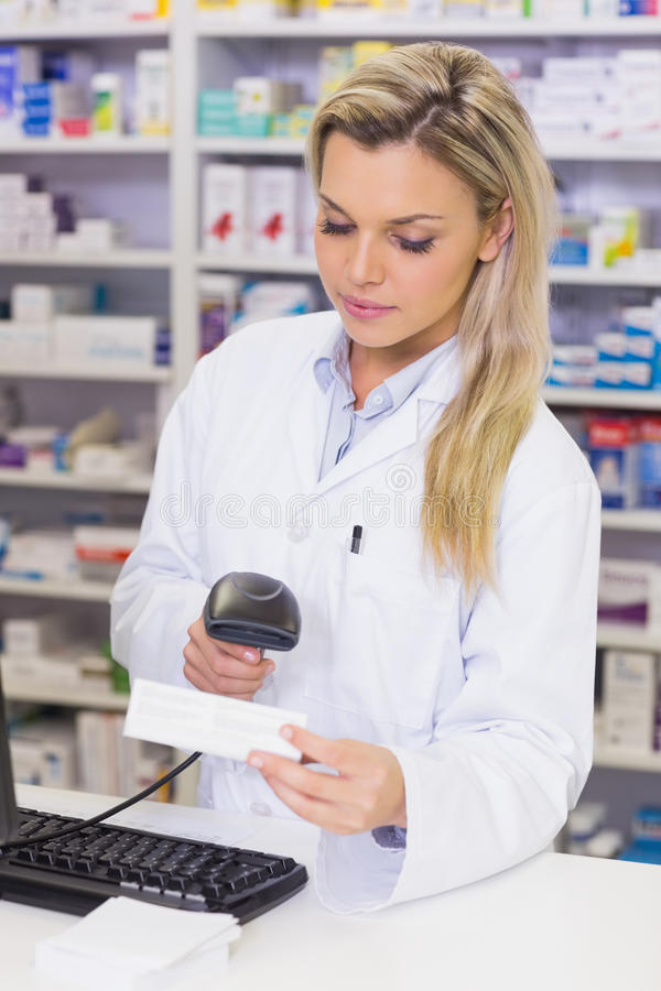 Pharmacist scanning medicines. At the hospital pharmacy stock photos