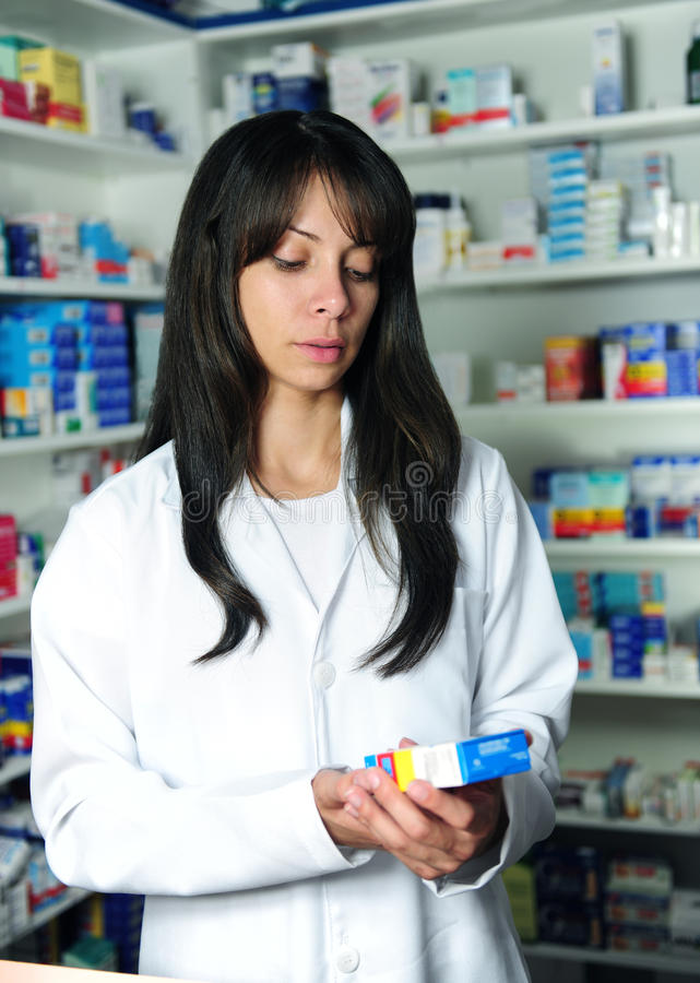 Pharmacist searching medicine royalty free stock photo