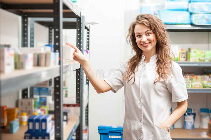 Pharmacist in the storage facility. Making an inspection. Healthcare business stock image