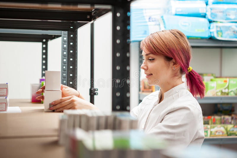 Pharmacist in the storage facility. Making an inspection. Healthcare business stock photos