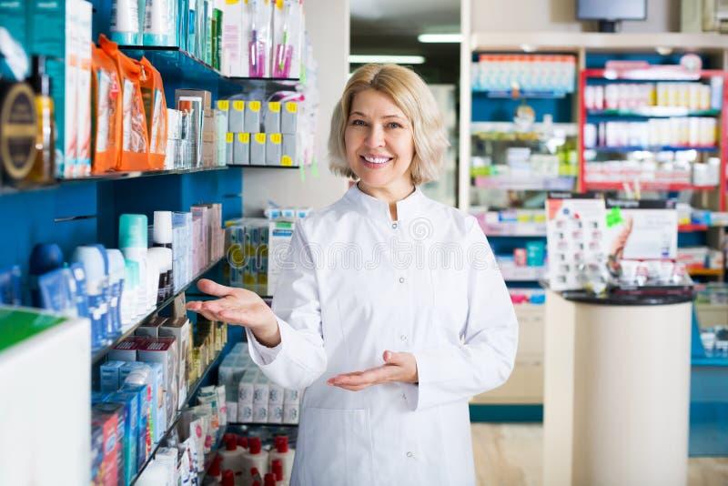 Pharmacists working in modern farmacy. Portrait of female pharmacists working in modern farmacy stock photos