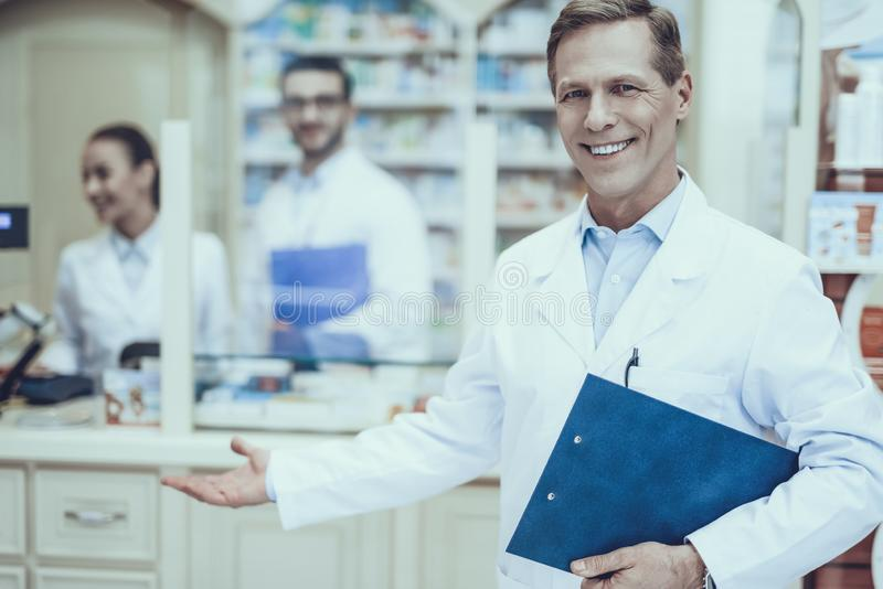 Pharmacists working in pharmacy royalty free stock images