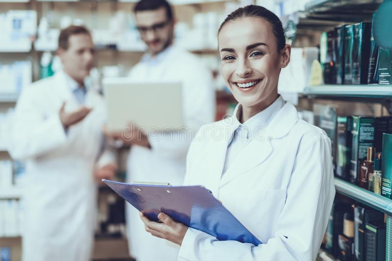 Pharmacists working in pharmacy royalty free stock photography