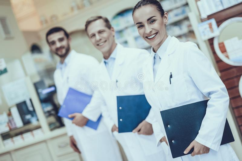 Pharmacists working in pharmacy royalty free stock photo