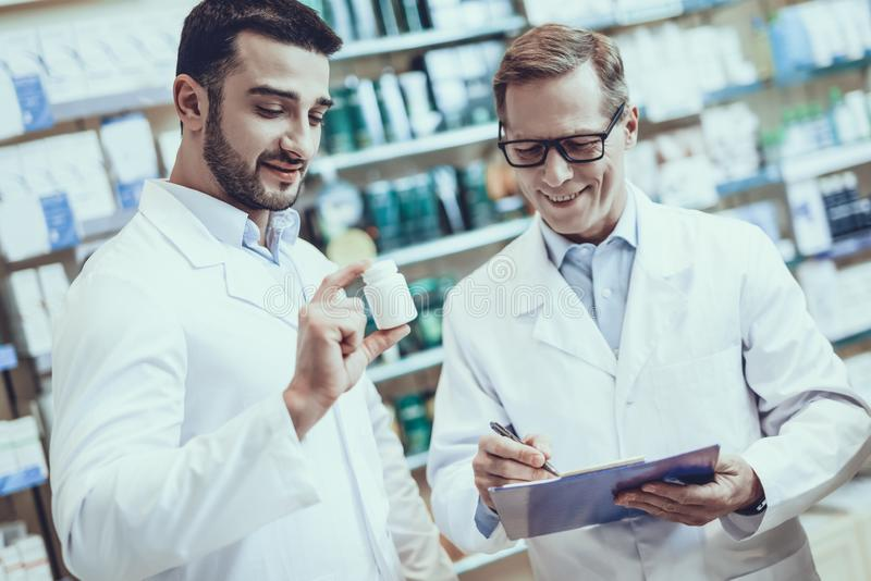 Pharmacists working in pharmacy royalty free stock image