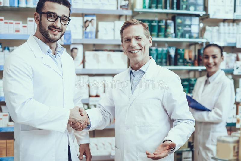Pharmacists working in pharmacy royalty free stock photos
