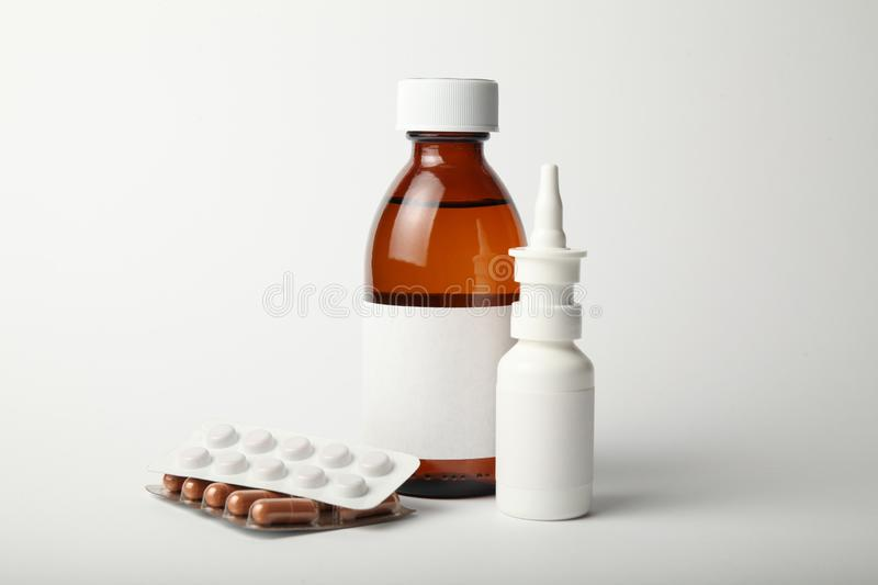 Pharmacological medicines for cold and flu virus. Antibiotics, drops spray in the nose.  stock photo