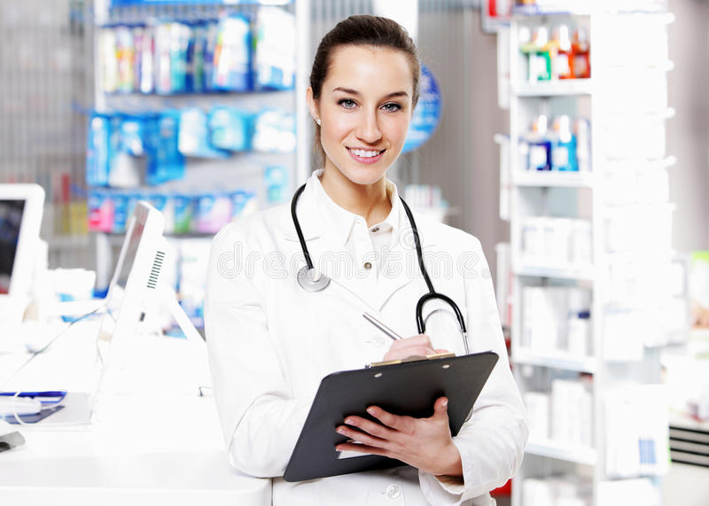 Download At pharmacy stock photo. Image of confidence, medicine - 24037724