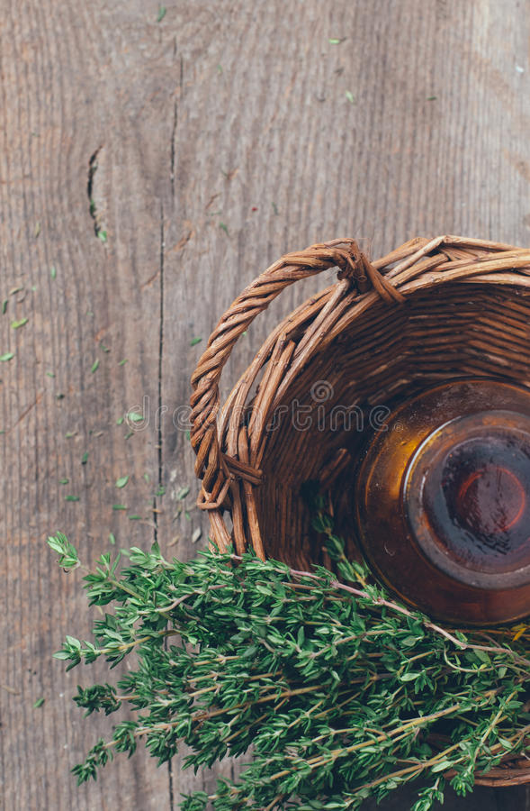 Pharmacy bottle and thyme in a basket stock images