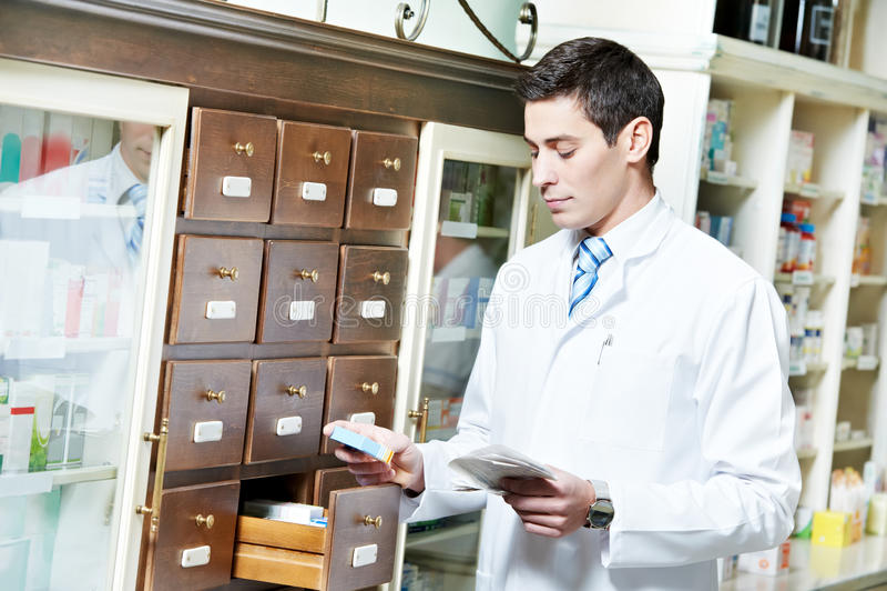 Download Pharmacy Chemist Man In Drugstore Stock Photo - Image: 24648288