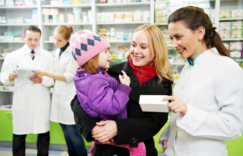 Pharmacy chemist, mother and child in drugstore royalty free stock image