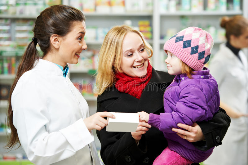 Pharmacy chemist, mother and child in drugstore stock photography