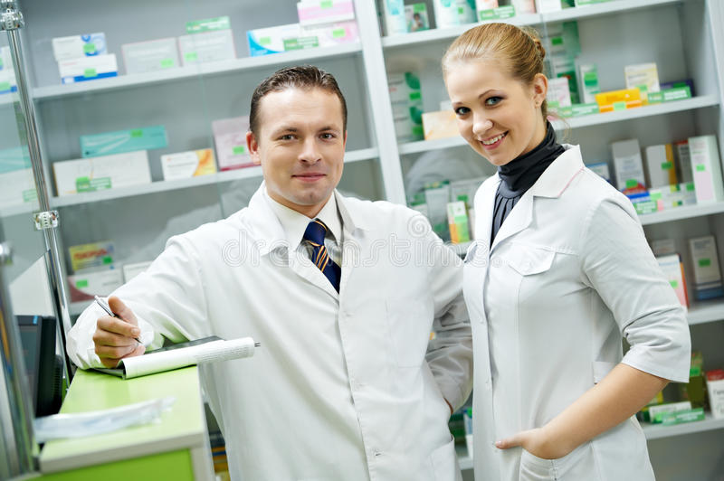 Pharmacy chemist team women and man in drugstore stock photography
